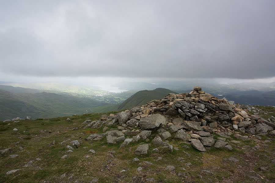 The summit cairn at Great Rigg looking south to Ambleside and Windermere