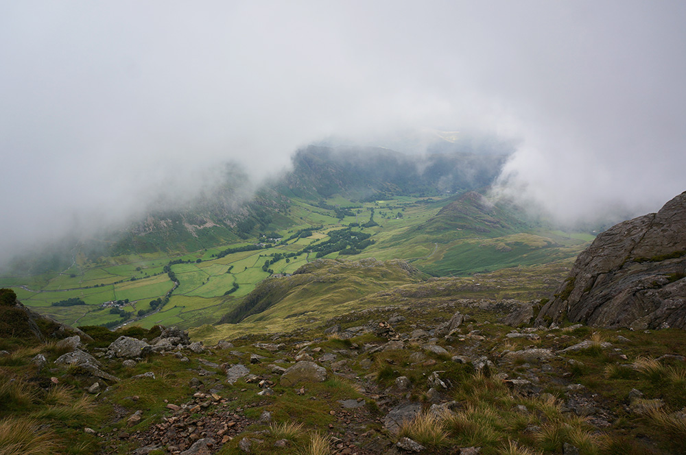 The view down to Lagdale and as mist descends over the top of Pike o'Blisco