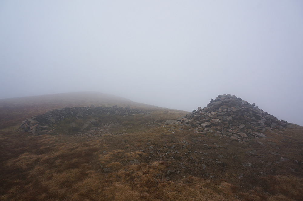 Little Sca Fell summit cairn in the mist