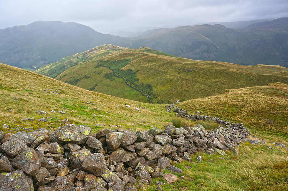 Stone wall with Arnison Crag